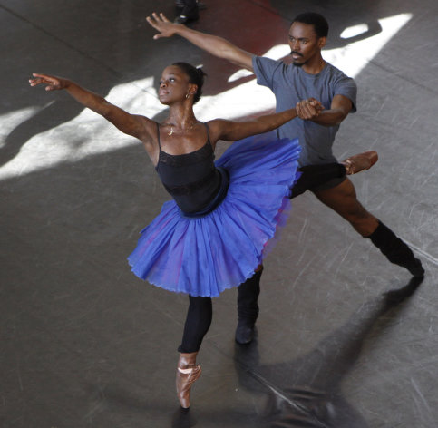 In this Tuesday July 10, 2012 photo, dancer Michaela DePrince, left, rehearses for her lead role in Le Corsaire with dancer Andile Ndlovu in Johannesburg. DePrince, who was born in Sierra Leone escaped civil war and was adopted by a family in the U.S. This will be DePrince's first professional full ballet role. (AP Photo Denis Farrell)