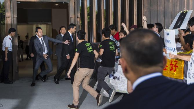 Students rush to meet Chief Executive Leung Chun-ying as he stepped out to meet the crowd at government headquarters in Hong Kong