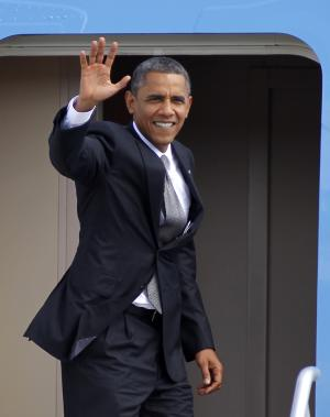 President Barack Obama waves as boards Air Force One, Tuesday, Oct. 23, 2012, at West Palm Beach Airport, in West Palm Beach, Fla. enroute to Ohio for a campaign stop after his final debate Monday night against Republican presidential candidate, former Massachusetts Gov. Mitt Romney at Lynn University in Boca Raton, Fla. (AP Photo/Terry Renna)