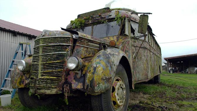 """FILE - This Dec. 7, 2005 file photo shows the 1939 International bus that author Ken Kesey and the Merry Pranksters drove into psychedelic history in 1964 on the Kesey family farm in Pleasant Hill, Ore. The Kesey family said Friday it is reviving efforts to restore the bus in time for it to take part in next year's 50th annivesary of its orginal trip. made famous in Tom Wolfe's 1968 book """"The Electric Kool-Aid Acid Test."""" (AP Photo/ Jeff Barnard, File)"""