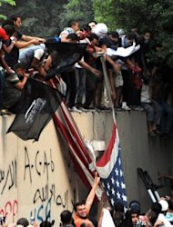 Egyptian protesters tear down the US flag at the US embassy in Cairo on September 11. An armed mob protesting over a film deemed offensive to Islam attacked the US consulate in Benghazi killing an American, hours after angry Islamists stormed Washington's embassy in Cairo