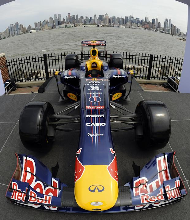 A Team Red Bull F1 car sits on the stage