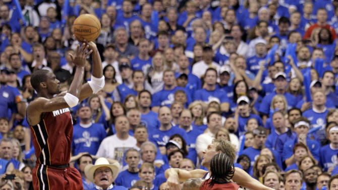 Miami Heat's Chris Bosh takes a shot in the final minute of the second half of Game 3 of the NBA Finals basketball game against the Dallas Mavericks Sunday, June 5, 2011, in Dallas. The Heat won 88-86 to take a 2-1 lead in the series. (AP Photo/Mark Humphrey)