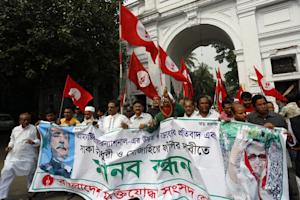 Bangladeshi activists and former fighters who fought…
