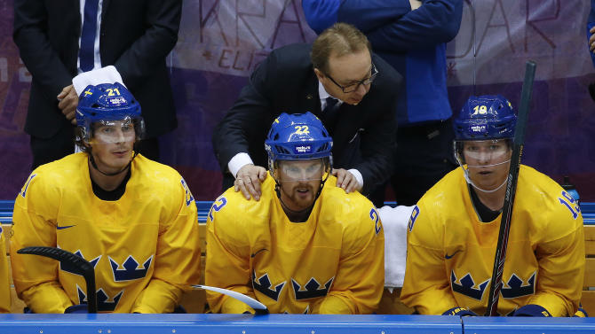 Sweden coach Par Marts congratulates players, from left, forward Loui Eriksson, Sweden forward Daniel Sedin and forward Nicklas Backstrom after a goal against Slovenia in the third period of a men's ice hockey game at the 2014 Winter Olympics, Wednesday, Feb. 19, 2014, in Sochi, Russia. Sweden won 5-0. (AP Photo/Mark Humphrey)