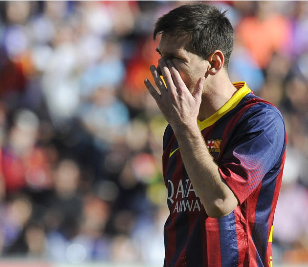 FC Barcelona's Lionel Messi gestures during a Spanish La Liga soccer match against Real Valladolid at the Jose Zorrilla stadium in Valladolid, Spain on Saturday March 8, 2014. (AP Photo/Israel L.