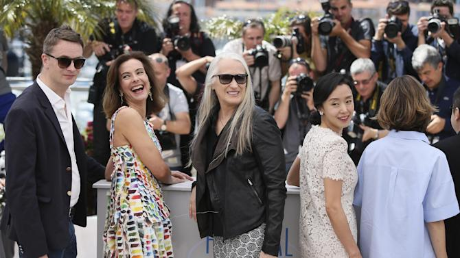 From left, Nicolas Winding Refn, Carole Bouquet, president of the jury Jane Campion, Jeon Do-yeon and Sofia Coppola pose for photographers during a photo call for members of the jury at the 67th international film festival, Cannes, southern France, Wednesday, May 14, 2014. (AP Photo/Alastair Grant)