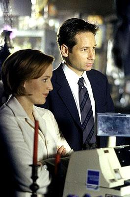 "Agents Scully (Gillian Anderson, L) and Mulder (David Duchovny, R) investigate a series of bizarre and connected murders with characteristics  pointing to the occult in the ""Theef"" episode of Fox's The X-Files X-Files"