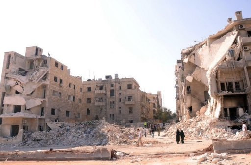 People walk past a row of destroyed buildings near the Al-Hayat Hospital in the northern Syrian city of Aleppo on September 10. Syrian troops on Tuesday pounded Aleppo to thwart a rebel advance in Syria&#39;s second city, activists said, as Hollywood star Angelina Jolie visited a Jordanian camp for refugees from the conflict