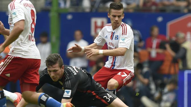 Hamburg SV's Stieber and Bayern Munich's Hoejbjerg fight for the ball during their German Bundesliga first division soccer match in Hamburg