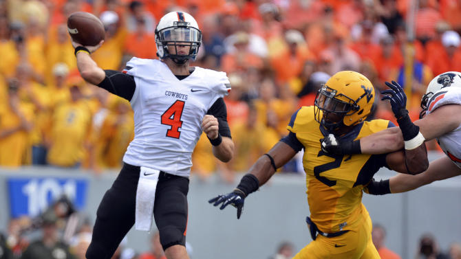 No. 21 Oklahoma St facing K-State after 1st loss