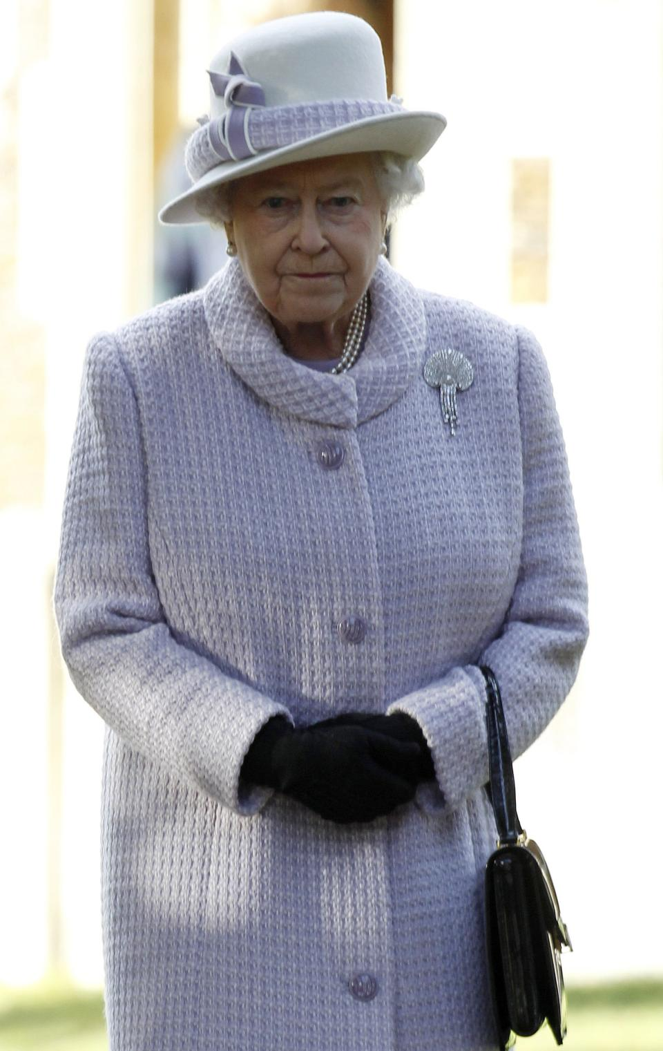 Britain's Queen Elizabeth II leaves after she and other members of the royal family attended a Christmas Service at St. Mary's church on the grounds of Sandringham Estate, the Queen's Norfolk retreat, England, Sunday, Dec. 25, 2011. (AP Photo/Lefteris Pitarakis)