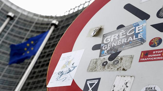 A sticker is affixed to a road sign outside the EU Commission headquarters in Brussels