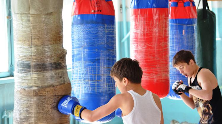 Local boys have a boxing training at a sport school where Tamerlan Tsarnaev, who was dubbed a suspect in the Boston Marathon bombings, had his training, in a small Kyrgyz city Tokmok east of the country's capital of Bishkek, on Friday, April 20, 2013. Tamerlan Tsarnaev was an amateur boxer with muscular arms and enough brio to arrive at a sparring session without protective gear. The Tsarnaev family arrived in the United States, seeking refuge from strife in their homeland. The family had moved from Kyrgyzstan to Dagestan, a predominantly Muslim republic in Russia's North Caucasus that has become an epicenter of the Islamic insurgency that spilled over from Chechnya. (AP Photo/Abylay Saralayev)