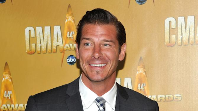 """FILE - This Nov. 10, 2010 file photo shows TV personality Ty Pennington at the 44th Annual Country Music Awards in Nashville, Tenn.  HLN said Wednesday, Jan. 2, 2013, that Pennington, who stars in """"Extreme Makeover: Home Edition,"""" will host a monthly series called """"American Journey."""" It will focus on people with unusual lifestyles, and debuts Saturday, Jan. 12. Each episode will air multiple times over the weekend on the network formerly known as CNN Headline News, with a new edition starting each month. (AP Photo/Evan Agostini, file)"""