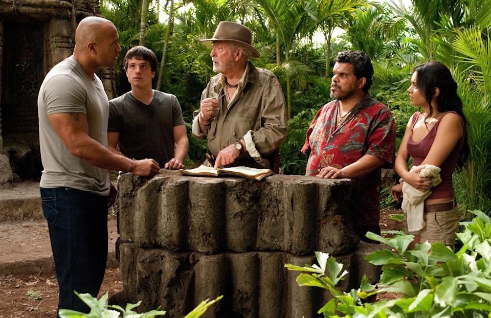 "In this image released by Warner Bros. Pictures, from left, Dwayne Johnson, Josh Hutcherson,Michael Caine, Luis Guzman, and Vanessa Hudgens are shown in a scene from ""Journey 2: The Mysterious Island."" (AP Photo/Warner Bros. Pictures, Ron Phillips)"
