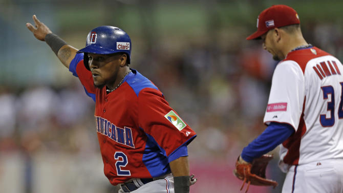 Dominican Republic's Erick Aybar, left, celebrates after scoring on a single hit by Edwin Encarnacion as Puerto Rico's starting pitcher Orlando Roman reacts in the first inning of their World Baseball Classic first round game in San Juan, Puerto Rico, Sunday, March 10, 2013. (AP Photo/Andres Leighton)