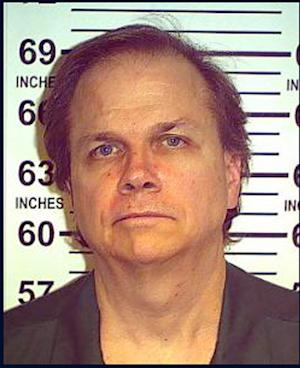 FILE - This May 15, 2012 file photo provided by the New York State Department of Corrections shows Mark David Chapman at the Wende Correctional Facility in Alden, N.Y.  Four letters from John Lennon's killer to the New York police officer who arrested him are on sale through a Los Angeles auction house. Gary Zimet, owner Moments in Time, said the letters from Mark David Chapman to Stephen Spiro are for sale starting Monday, Feb. 18, 2013 for a fixed price of $75,000. Zimet says he is selling the letters on behalf of Spiro, who arrested Chapman on Dec. 8, 1980, shortly after Lennon was shot outside his Manhattan building.  (AP Photo/New York State Department of Corrections, File)