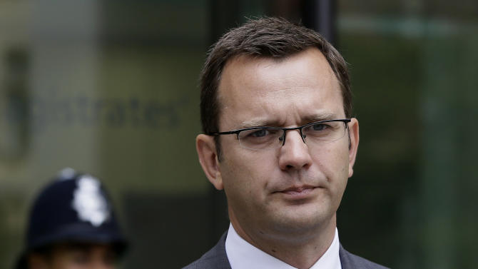 FILE This Thursday, Aug. 16, 2012 file photo shows British Prime Minister David Cameron's former chief communications adviser and former editor of the News of the World Andy Coulson, after appearing in Westminster Magistrates Court on phone hacking charges, in London.  Officials have charged the British prime minister's former media aide and the ex-chief of Rupert Murdoch's News International with bribery offenses. Britain's Crown Prosecution Service said Tuesday Nov. 20, 2012 that Andy Coulson and Rebekah Brooks were among four people being charged with conspiracy to commit misconduct in public office.  (AP Photo/Kirsty Wigglesworth, File)