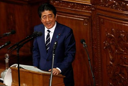 Japan's Prime Minister Shinzo Abe makes a policy speech at the start of the ordinary session of parliament in Tokyo