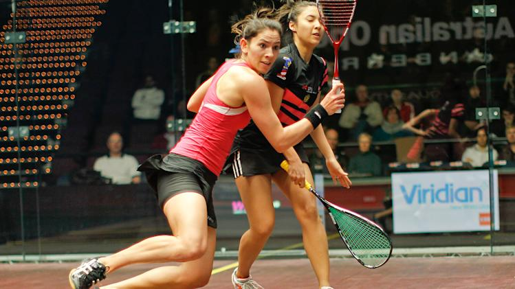Joelle King (left) and Delia Arnold of Malaysia fight for position during their second round match at the 2011 Australian Open squash tournament in Canberra on August 11, 2011