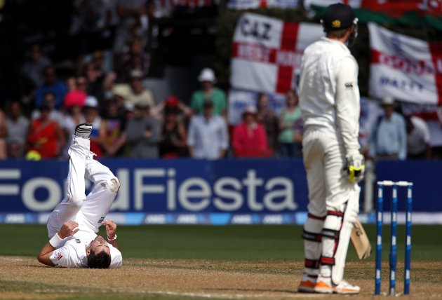 New Zealand's Martin looks at England's Anderson as he lies on the pitch during third day second test in Wellington