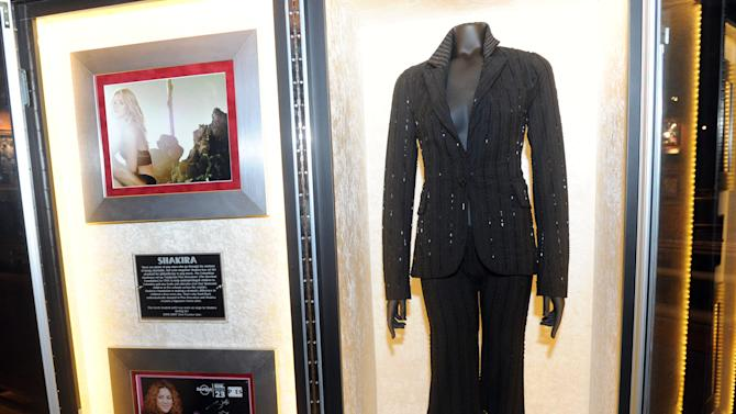 "The gown Shakira wore on stage during her 2006 Oral Fixation tour is displayed at the launch of Hard Rock International's traveling music memorabilia collection, ""Music GIves Back,"" Wednesday, Feb. 13, 2013, at Hard Rock Cafe New York.   ""Music Gives Back"" focuses on artists who have worked with Hard Rock on charitable campaigns  and will be on tour at Hard Rock locations in the U.S. throughout 2013. (Photo by Diane Bondareff/Invision for Hard Rock International/AP Images)"
