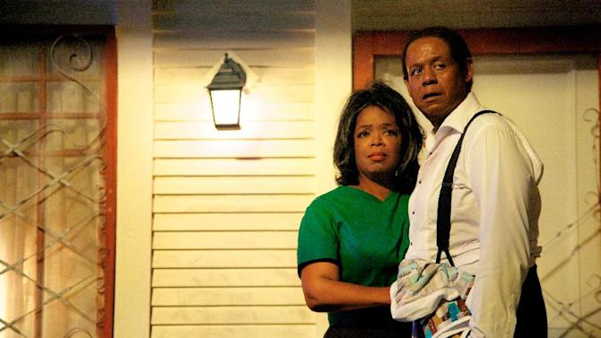 """FILE - This undated file film image provided by The Weinstein Company shows Oprah Winfrey as Gloria Gaines, left, and Forest Whitaker as Cecil Gaines in a scene from """"Lee Daniels' The Butler."""" """"Lee Daniels' The Butler"""" served up another box office-topping weekend, earning $17 million according to studio estimates Sunday, Aug. 25, 2013. (AP Photo/The Weinstein Company, Anne Marie Fox, File)"""