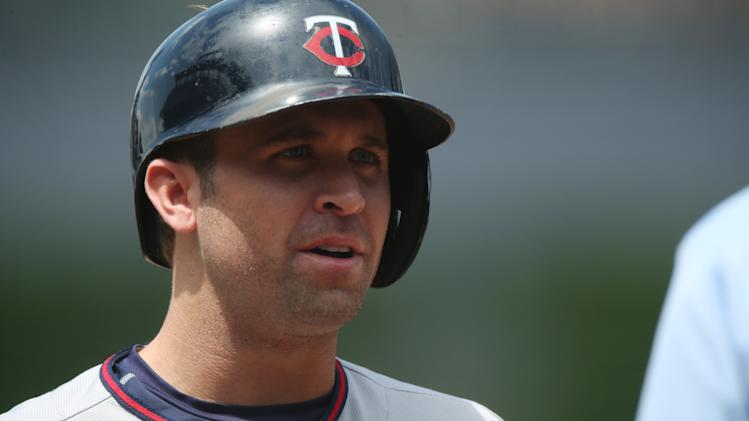 Minnesota Twins' leadoff hitter Brian Dozier steps to plate to face the Colorado Rockies in the first inning of an interleague baseball game in Denver on Saturday, July 12, 2014. (AP Photo/David Zalubowski)