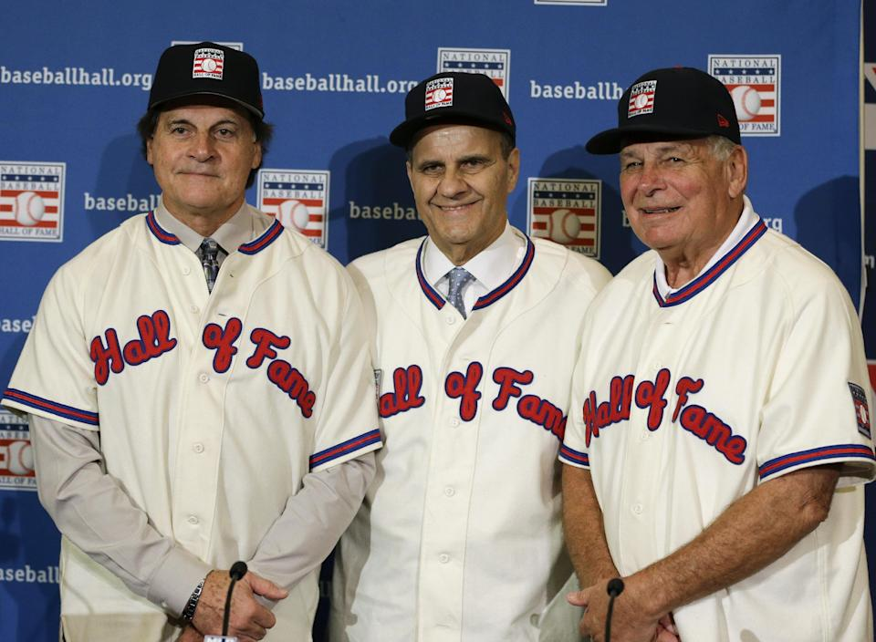 Retired managers, from left, Tony La Russa, Joe Torre and Bobby Cox gather for a photo after it was announced that they were unanimously elected to the baseball Hall of Fame, at a news conference during MLB winter meetings in Lake Buena Vista, Fla., Monday, Dec. 9, 2013. (AP Photo/John Raoux)