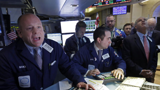 Specialist Michael O'Connor, left, calls out prices for Home Depot shares on the floor of the New York Stock Exchange Tuesday, Feb. 26, 2013.  Strong earnings reports from Home Depot and Macy's helped lift stock indexes in early trading on Wall Street Tuesday. A jump in home sales and consumer confidence also brought buyers back to the market. (AP Photo/Richard Drew)