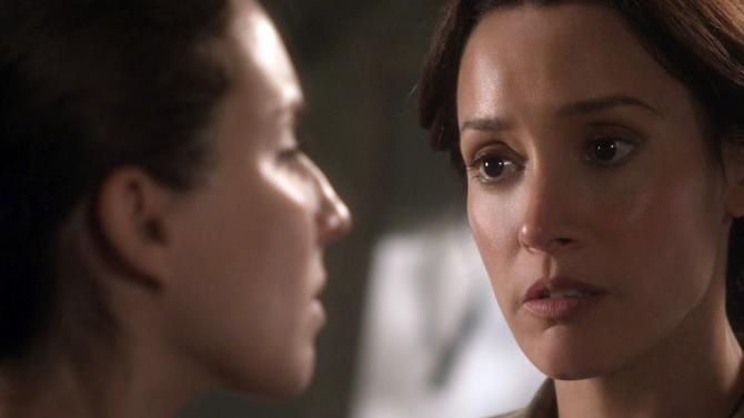 """This image provided by WIGSCO, LLC shows Jennifer Beals, right, as Maj. Jo Stone in WIGS' """"Lauren,"""" confronting co-star Troian Bellisario as a female soldier who reports being raped. The three-part Web series gives a close-up look at the challenges and obstacles women service members face in trying to find justice after being raped. (AP Photo/WIGSCO, LLC)"""