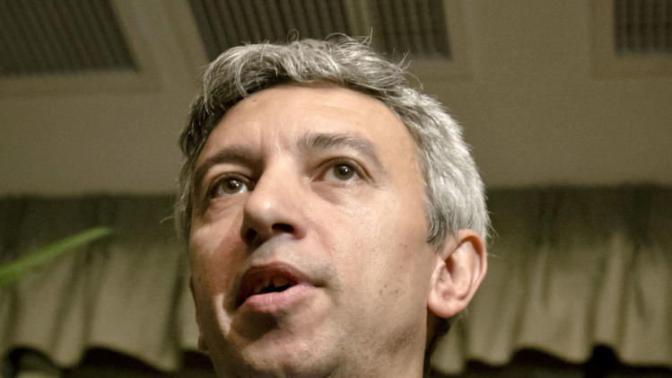 In this photo taken on Dec. 4, 2012, Dan Diaconescu, the leader of the populist People's Party during an interview with the Associated Press in Bucharest, Romania. Diaconescu, a media tycoon has emerged as a key player in Romania's bitterly contested parliamentary election. Diaconescu's party is running third in Sunday's vote, according to polls. The gray-haired, multimillionaire talk show host from Romania's disenfranchised south appears to be tapping into widespread discontent with traditional political parties seen as arrogant, sniping and corrupt. Romania will hold parliamentary elections on Dec. 9, 2012. (AP Photo/Vadim Ghirda)