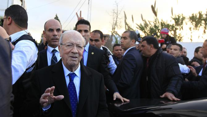 Essebsi, leader of Tunisia's secular Nidaa Tounes party and a presidential candidate, gestures after casting his vote at a polling station in Tunis