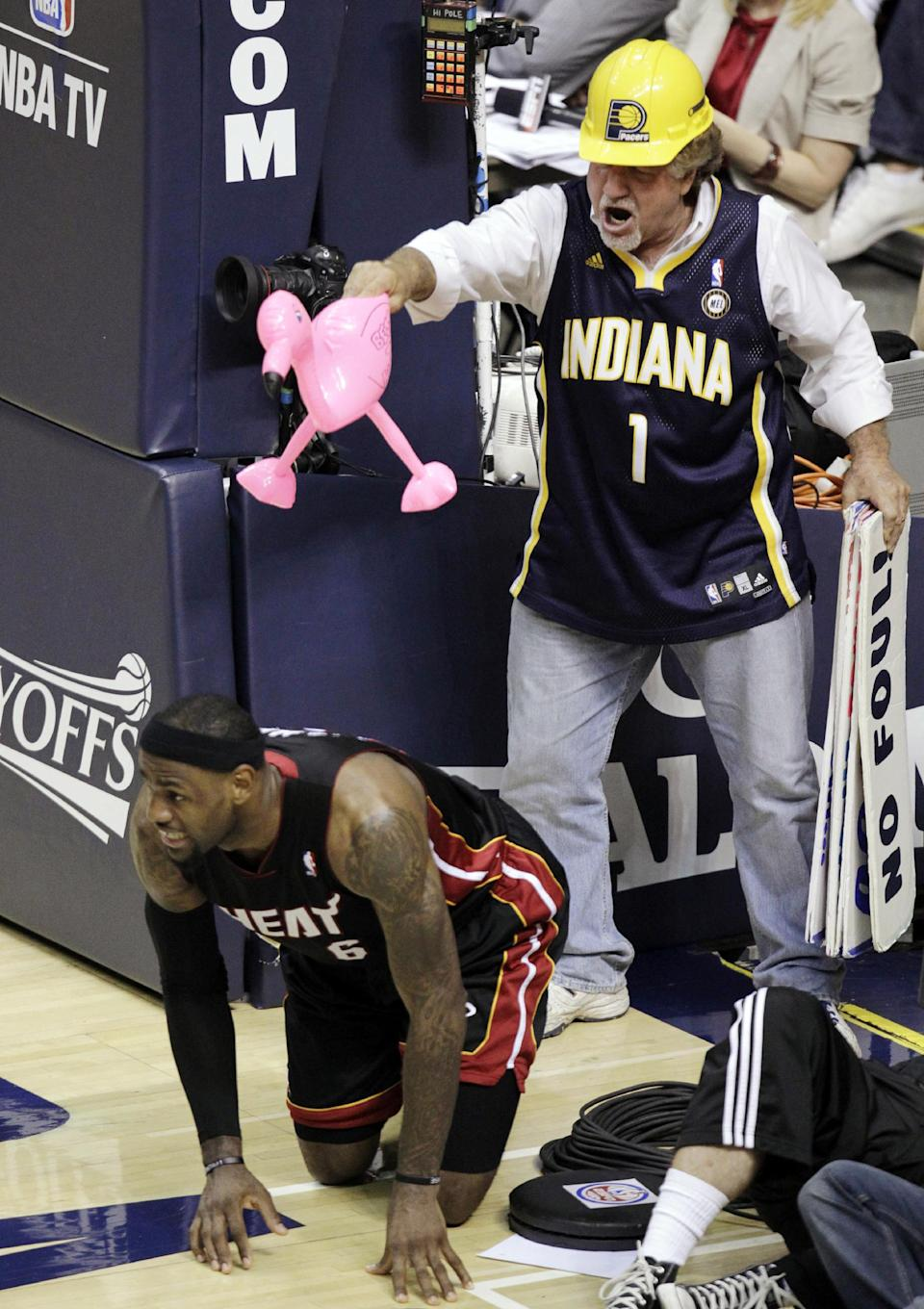 Indiana Pacers fan Matt Asen taunts Miami Heat forward LeBron James after he fell to the floor following a missed lay up on a fast break during the first half of Game 6 of their NBA basketball Eastern Conference semifinal playoff series in Indianapolis, Thursday, May 24, 2012. (AP Photo/Michael Conroy)