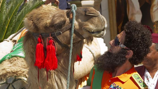 Actor Sacha Baron Cohen poses with a a camel during a photo call for The Dictator at the 65th international film festival, in Cannes, southern France, Wednesday, May 16, 2012. (AP Photo/Joel Ryan)