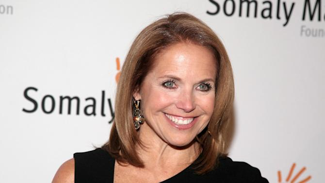 """FILE - This Oct. 23, 2013 file photo shows TV host Katie Couric at the Somaly Mam Foundation Gala in New York. Couric is joining Yahoo to anchor a news program for the Internet company as it tries to expand its audience and sell more advertising. An announcement on Monday, Nov. 25, confirms recent published reports that Couric would diversify into online video programming after spending decades in broadcast television as a talk-show host and news anchor. The 56-year-old Couric will continue to host her daytime talk show, """"Katie,"""" on ABC even after she becomes Yahoo's """"global anchor"""" beginning next year. (Photo by Andy Kropa/Invision/AP, File)"""