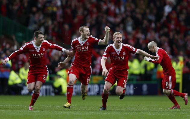 Aberdeen's Jack, Reynolds, Robson and Flood react as the winning penalty is taken against Inverness Caledonian Thistle during their Scottish League Cup final soccer match in Glasgow
