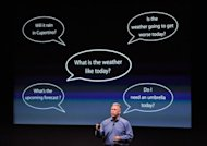 Apple executive Phil Schiller demonstrates the Siri function on the new iPhone 4s at the company's headquarters in Cupertino, California. One Siri user in China noted how efficient it was at finding brothels, rather than restaurants that serve typically Chinese dishes