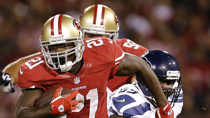 San Francisco 49ers running back Frank Gore (21) rushes past Seattle Seahawks defensive tackle Clinton McDonald during the second half of an NFL football game in San Francisco, Thursday, Oct. 18, 2012. (AP Photo/Marcio Jose Sanchez)
