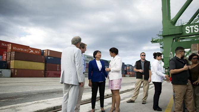 U.S. Commerce Secretary Pritzker talks to the general director of Mariel Port Igarza at the Mariel port on the outskirts of Havana, Cuba