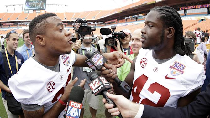 Alabama's Eddie Lacy interviews Christion Jones during Media Day for the BCS National Championship college football game Saturday, Jan. 5, 2013, in Miami. Alabama faces Notre Dame in Monday's championship game. (AP Photo/David J. Phillip)