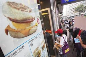 People queue for free offers McMuffin outside a McDonald's at Sham Shui Po in Hong Kong