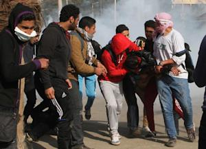 Students help a wounded comrade during clashes with …