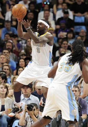 Denver Nuggets guard Ty Lawson, back, takes to the air to pull in the ball as forward Kenneth Faried looks on against the Los Angeles Lakers in the first quarter of Game 3 of the teams' first-round NBA playoff series in Denver on Friday, May 4, 2012. (AP Photo/David Zalubowski)