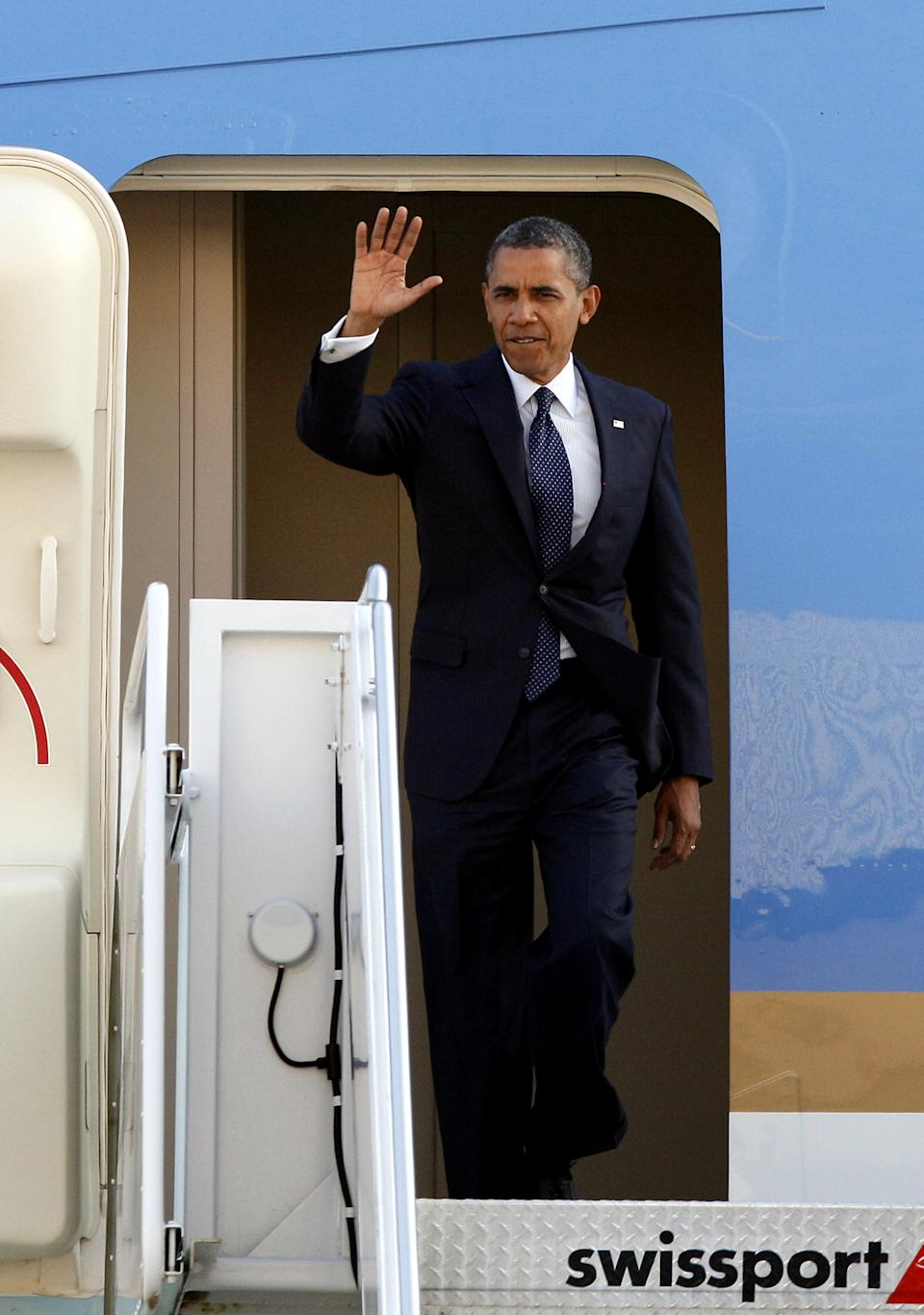 President Barack Obama arrives at JFK International Airport in New York, Wednesday, Aug. 22, 2012, on his way to a visit in New York City where he will attend several fundraiser events. (AP Photo/David Karp)