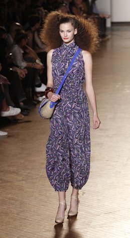 FILE - In this Sept. 14, 2010 file photo, the Marc by Marc Jacobs spring 2011collection is modeled during Fashion Week in New York. Based on runway and retailer previews, the must-have look in 2013 could be menswear-inspired and tailored, or ladylike chic. Check off dressed-up shorts, jumpsuits and slinky mermaid gowns. It was largely the same story for fall 2012 and spring before that. 2011, too. (AP Photo/Seth Wenig, File)