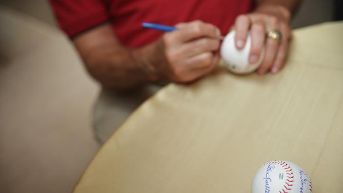 Former Major League Baseball pitcher and Hall of Fame inductee signs autographs on baseballs on July 23, 2014 on Capitol Hill in Washington