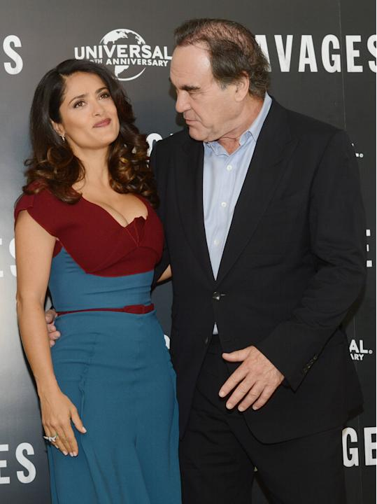 Oliver Stone and Salma Hayek at a photocall for Savages at the Mandarin Oriental, London, England- 19.09.12Mandatory Credit: WENN.com