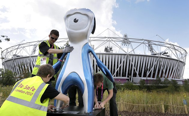 Workmen position a Mandeville official Paralympic mascot as preparations are made at the Olympic Park ahead of the 2012 Paralympics, Tuesday, Aug. 28, 2012, in London. The Paralympics will start with the opening ceremony on Aug. 29. (AP Photo/Kirsty Wigglesworth)